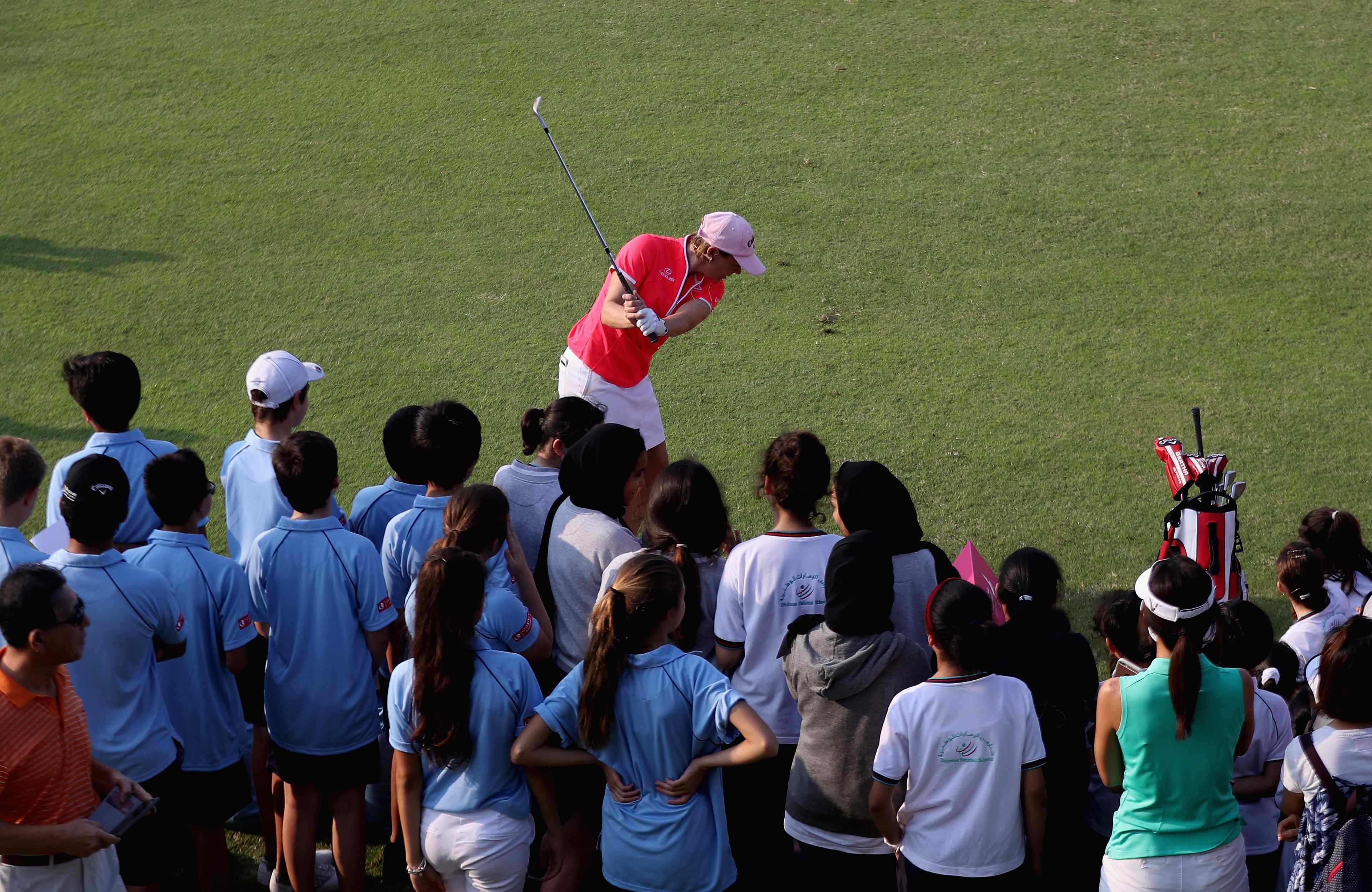 annika-takes-swing-as-students-watch-on