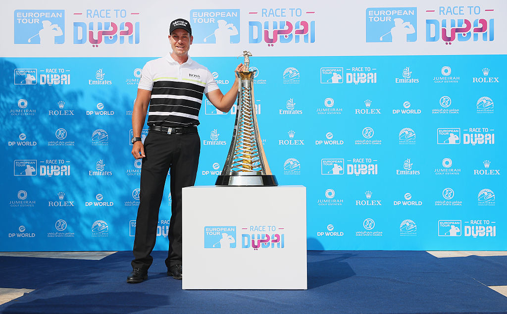 DUBAI, UNITED ARAB EMIRATES - NOVEMBER 16: Henrik Stenson of Sweden stands in front of the new Race to Dubai brand, featuring the official Dubai logo. Revealed at Jumeirah Golf Estates ahead of the DP World Tour Championship on the Earth Course at Jumeirah Golf Estates on November 16, 2016 in Dubai, United Arab Emirates. (Photo by Andrew Redington/Getty Images)