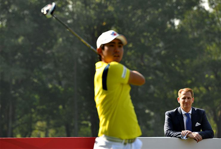Josh-Burack-watching-golf-3