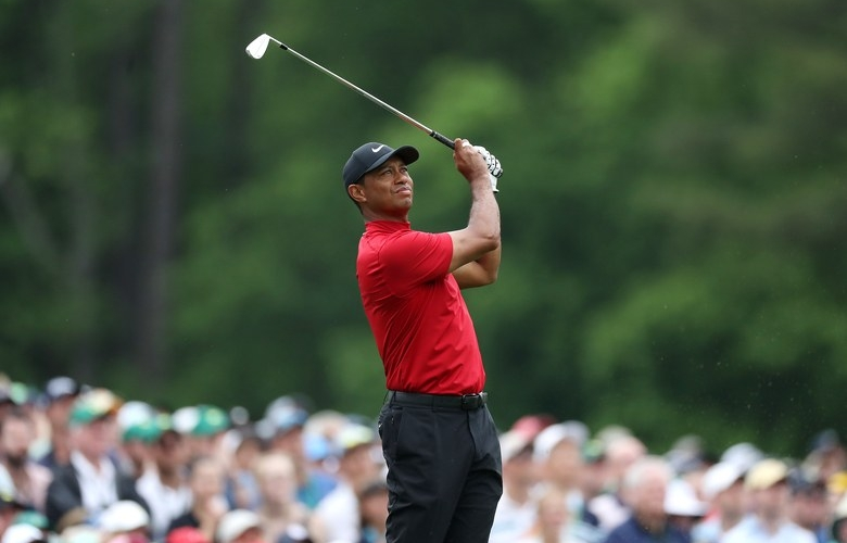 afb53ba481bf Tiger Woods of the United States plays a shot from the 12th tee during the  final round of the Masters at Augusta National Golf Club on April 14